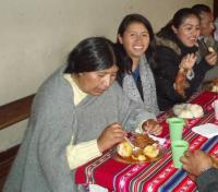 Sara Mamani Tito, center, enjoys an Andina lunch break with fellow Quaker Education Workshop participants